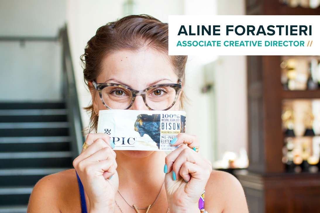 Associate Creative Director Aline Forastieri with an Epic bar